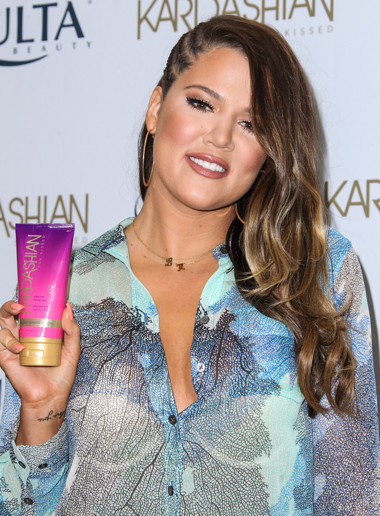 Khloe Kardashian Wears Side Swept Braids Trend