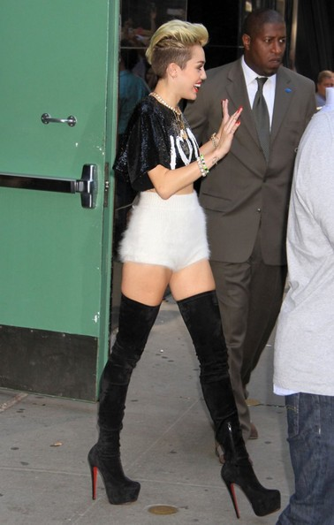 Miley Cyrus Spotted In White Fur High-Waisted Shorts and Black Tall Boots 3