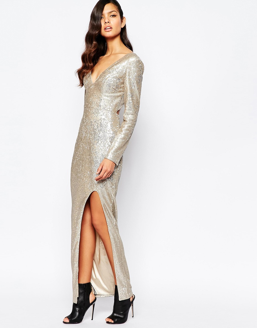 A shiny sweater dress for homebodies that don't feel like shedding layers for some New Year's Eve party—*with a twist*. The sleeves come with a slit so you won't even have to roll them up to show off new Christmas jewelry. Glitter Knit Dress, $84; mainflyyou.tk